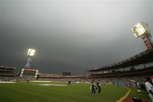 Sri Lanka and Indian cricketers leave the Eden Gardens stadium as it rains during the first one-day international match between India and Sri Lanka in Kolkata on Thursday, February 8, 2007.