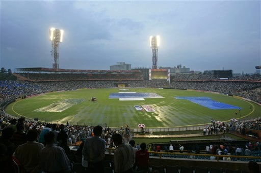 Cricket fans, sitting in the stands, wait for play to start after it rained over Eden Gardens during the first one-day international cricket match between India and Sri Lanka in Kolkata on Thursday February 8, 2007.