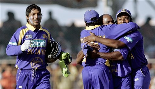 Sri Lankan cricketers Kumar Sangakkara, extreme left, runs to join other teammates celebrate their team's victory over India in the second one-day international in Rajkot, India, Sunday, February 11, 2007.