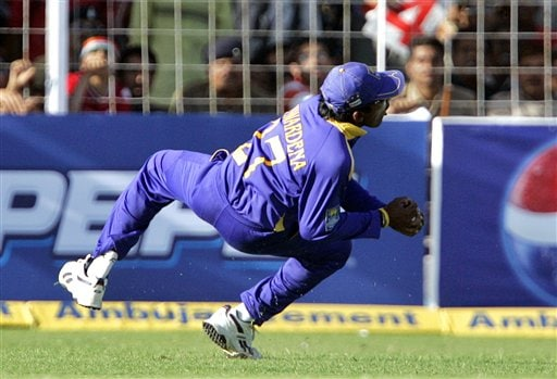 Sri Lankan cricketer Mahela Jayawardene takes a successful catch for the dismissal of India's Harbhajan Singh during the second one-day international in Rajkot, India, Sunday, February 11, 2007.