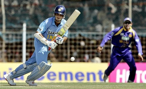 Indian cricketer Sourav Ganguly, left, plays a shot as Sri Lanka's Tillakaratne Dilshan looks on during the second one-day international in Rajkot, India, Sunday, February 11, 2007.