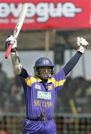 Sri Lankan cricketer Kumar Sangakkara celebrates his century against India during the second one-day international in Rajkot, India, Sunday, February 11, 2007.
