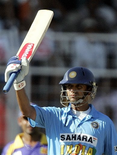 Indian captain Rahul Dravid celebrates his half century against Sri Lanka during the third one-day international cricket match in Goa, India.