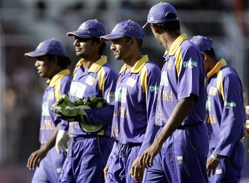 Sri Lankan cricketers walk back to the dressing room after losing the third one-day international match against India in Goa, India.
