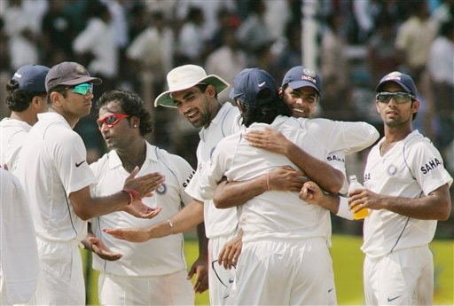 Indian cricket players celebrate the stumping of Bangladesh batsman Abdul Razzaq, unseen, after the third umpire's decision on the fourth day of the first cricket test at the Bir Sreshta Shahid Ruhul Amin Stadium in Chittagong.