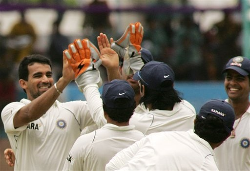Indian bowler Zaheer Khan, left, is congratulated by Indian players after he took the wicket of Bangladesh batsman Shahriar Nafeez, unseen, on the fourth day of the first cricket test against host Bangladesh at the Bir Sreshta Shahid Ruhul Amin Stadium in Chittagong.