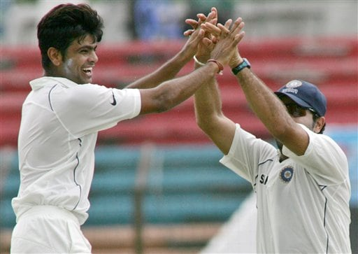 Indian bowler R. P. Singh, left, is congratulated by Yuvraj Singh after the former took the wicket of Bangladesh captain Habibul Bashar, unseen, on the fourth day of the first cricket test against host Bangladesh at the Bir Sreshta Shahid Ruhul Amin Stadium in Chittagong.