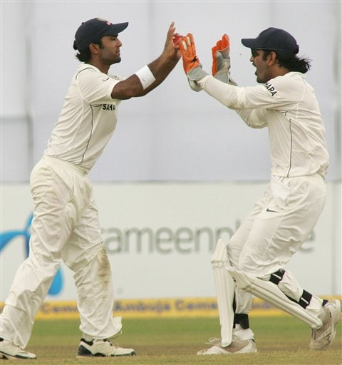 Indian wicket keeper Mahendra Dhoni, right, congratulates Dinesh Karthik after he took the catch to dismiss Bangladesh vice-captain Mohammed Ashraful on the fourth day of the first cricket test at the Bir Sreshta Shahid Ruhul Amin Stadium in Chittagong.