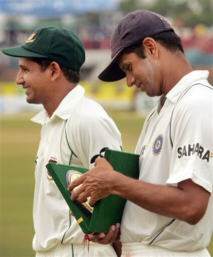 Indian cricket Captain Rahul Dravid, right, looks at a memento, as Bangladesh Captain Habibul Bashar looks on at a ceremony held at the end of the first test between hosts Bangladesh and India at the Bir Sreshta Shahid Ruhul Amin Stadium in Chittagong.