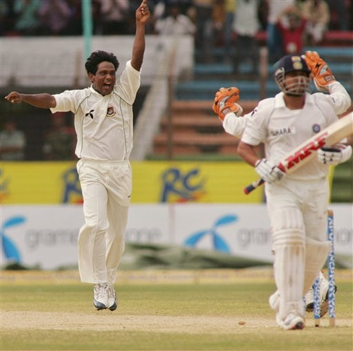 Bangladesh bowler Mohammed Rafique, left, reacts after taking the wicket of Indian batsman Sachin Tendulkar, right, on the final day of their first cricket test at the Bir Sreshta Shahid Ruhul Amin Stadium in Chittagong.