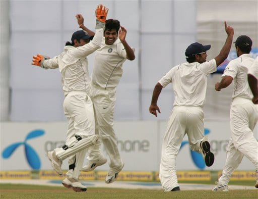 Indian cricket players run in to congratulate bowler R P Singh, second left, after he took the wicket of Bangladesh batsman Shahriar Nafeez, unseen, on the final day of their first cricket test at the Bir Sreshta Shahid Ruhul Amin Stadium in Chittagong.