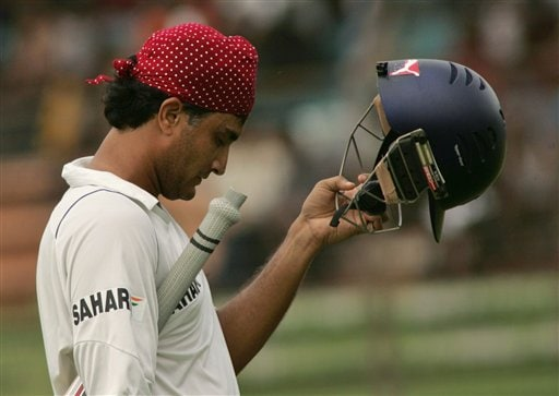 India's Sourav Ganguly removes his helmet as he returns to the pavilion on the final day of the first cricket test against Bangladesh at the Bir Sreshta Shahid Ruhul Amin Stadium in Chittagong.