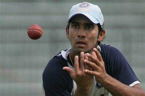 Indian cricket team member Dinesh Karthik prepares to catch the ball during a practice session at the Shere Bangla National Stadium in Dhaka, Bangladesh, Thursday, May 24, 2007. The first test between hosts Bangladesh and India ended in a draw, the second test begins in Dhaka Friday.