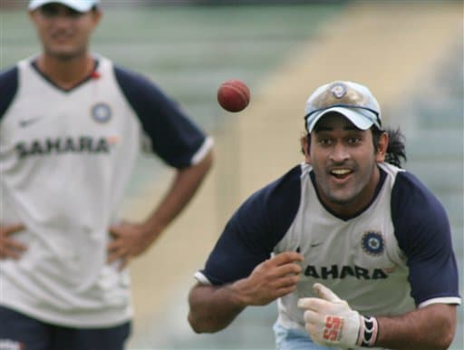 Indian cricket team wicketkeeper Mahendra Dhoni prepares to catch the ball as Sourav Ganguly looks on during a practice session at the Shere Bangla National Stadium in Dhaka, Bangladesh, Thursday, May 24, 2007. The first test between hosts Bangladesh and India ended in a draw, the second test begins in Dhaka Friday.