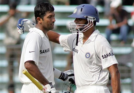 Indian cricketer Wasim Jafar, left, is congratulated by Captain Rahul Dravid after he scored a century on the first day of the second cricket test match between India and Bangladesh at the Shere Bangla National Stadium in Dhaka, Bangladesh, Friday, May 25, 2007.