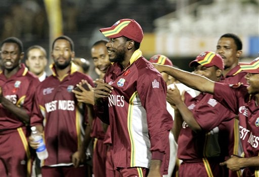 West Indies' Christophor Gayle, center, is congratulated by teammates as he proceeds to receive the Man-of-the-Tournament award during the awards ceremonies of the ICC Champions Trophy cricket tournament in Mumbai. Australia won beating West Indies by 8 wickets.