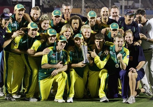 Australian cricket team members celebrate on receiving the ICC Champions Trophy cricket tournament trophy after beating West Indies in the finals.