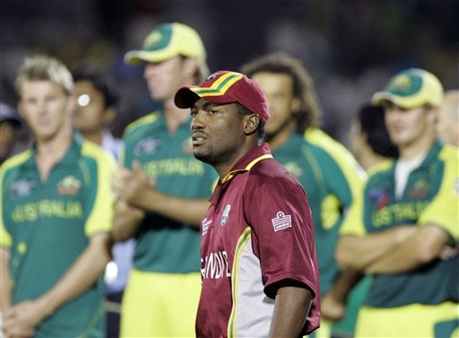 West Indies' cricket captain Brian Lara proceeds to receive his medal during the awards ceremonies of the ICC Champions Trophy cricket tournament in Mumbai.