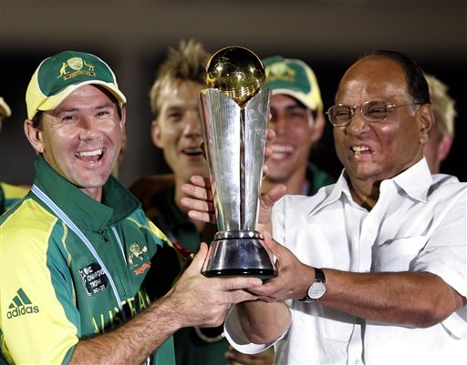 Australian cricket team captain Ricky Ponting, left, receives the ICC Champions Trophy from Board of Control for Cricket in India Sharad Pawar, right, after beating West Indies in the finals, in Mumbai.