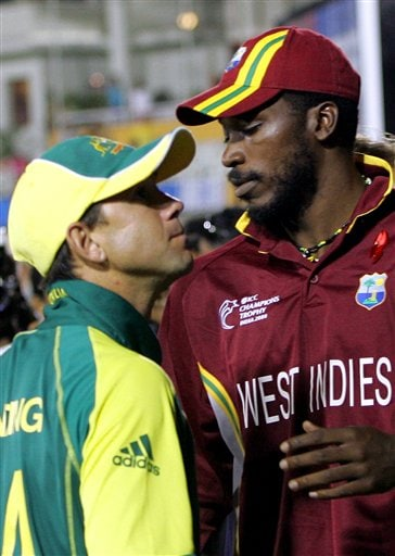 Australian cricket team captain Ricky Ponting, left, is congratulated by West Indies' Christophor Gayle after Australia won the ICC Champions Trophy cricket tournament finals, in Mumbai.