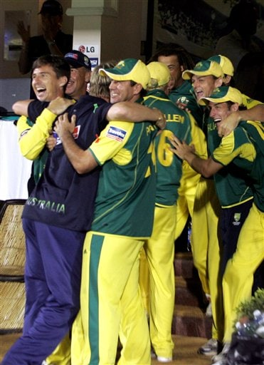 Australian cricket team members celebrate on winning the ICC Champions Trophy cricket tournament after beating West Indies in the finals, in Mumbai.