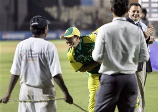 Australian cricket captain Ricky Ponting, second left, bows to a cheering audience after Australia won the ICC Champions Trophy cricket tournament trophy, beating West Indies in the finals in Mumbai.