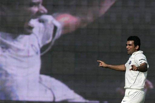 Zaheer Khan celebrates dismissal of England captain Kevin Pietersen before a giant screen during the first Test match between India and England in Chennai on Thursday, December 11, 2008. (AP Photo)