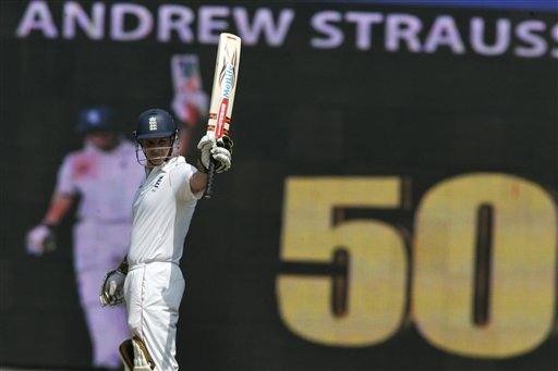 Andrew Strauss, standing before an electronic scoreboard, acknowledges the crowd after scoring fifty runs during the first Test match between India and England in Chennai on Thursday, December 11, 2008. (AP Photo)