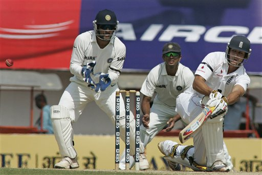 Alastair Cook plays a shot as MS Dhoni gestures during their first Test match in Chennai on Thursday, December 11, 2008. (AP Photo)