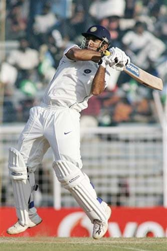 India's MS Dhoni hits a shot during the second day of the first Test match between India and England in Chennai on Friday. (AP Photo)