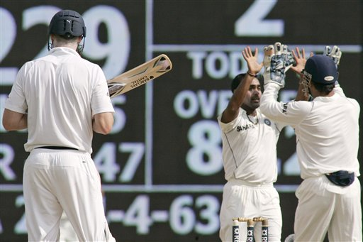 India's Amit Mishra and MS Dhoni celebrate the dismissal of England's Andrew Flintoff during second day of the first Test match between India and England in Chennai on Friday.(AP Photo)