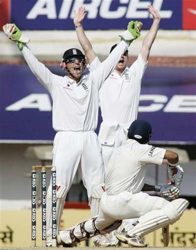 England's wicketkeeper Matt Prior and Paul Collingwood make a successful leg before wicket appeal against Gautam Gambhir during the second day of the first Test match between India and England in Chennai on Friday.(AP Photo)