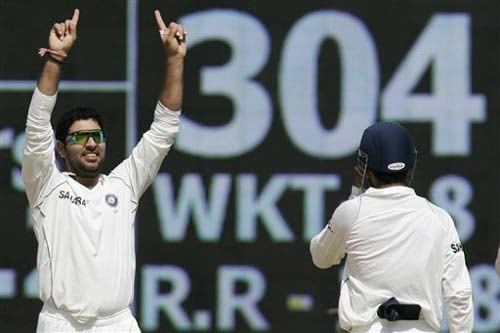 India's Yuvraj Singh celebrates the dismissal of Steve Harmison as Gautam Gambhir runs in to congratulate him during the second day of the first Test between India and England in Chennai on Friday.(AP Photo)
