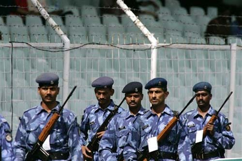 Indian paramilitary soldiers patrol inside the Chidambaram Stadium during the second day of the first Test between India and England in Chennai on Friday. (AP Photo)