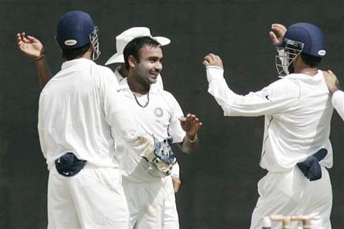 Teammates congratulate bowler Amit Mishra after the dismissal of England's James Anderson during the second day of the first Test match between India and England in Chennai on Friday. (AP Photo)