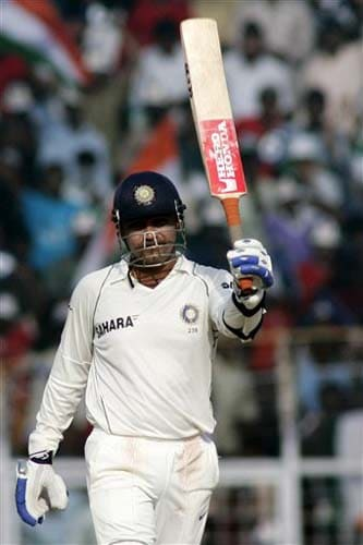 India's Virender Sehwag acknowledges the crowd after scoring fifty runs during the fourth day of the first Test match between India and England in Chennai on Sunday.(AP Photo)