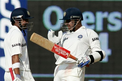 India's Virender Sehwag gestures as team-mate Gautam Gambhir looks on during the fourth day of the first Test match between India and England in Chennai on Sunday. (AP Photo)