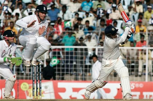 India's Virender Sehwag hits a shot as England's Ian Bell jumps in the air to avoid collision while wicketkeeper Matt Prior takes his position during the fourth day of the first Test match between India and England in Chennai on Sunday. (AP Photo)