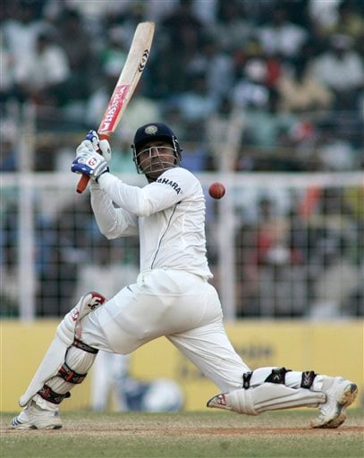 India's Virender Sehwag hits a shot during the fourth day of the first Test match between India and England in Chennai on Sunday. (AP Photo)