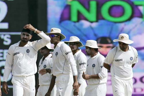 India's Harbhajan Singh and other teammates walk back to their respective positions after an unsuccessful appeal against England's Andrew Strauss during the fourth day of the first Test match between India and England in Chennai on Sunday.(AP Photo)