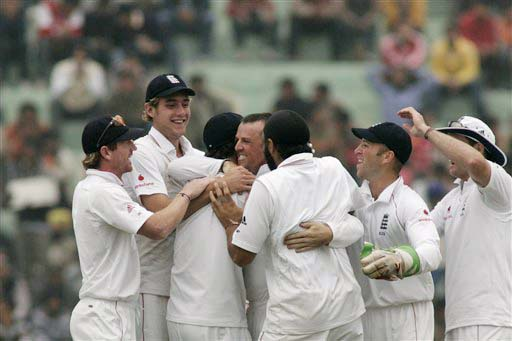 England team celebrates the dismissal of Amit Mishra during the second day of the second Test match between India and England in Mohali on Saturday. (AP Photo)