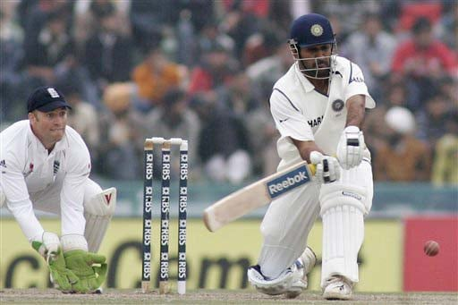 MS Dhoni hits a shot as wicketkeeper Matt Prior takes his position during the second day of the second Test match between India and England in Mohali on Saturday. (AP Photo)