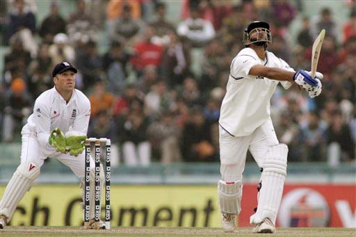Matt Prior and Rahul Dravid look up after the latter hit a shot during the second day of the second Test match between India and England in Mohali on Saturday. (AP Photo)