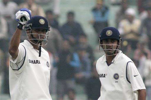 Rahul Dravid gestures after scoring his 26th century as team-mate Gautam Gambhir looks on during the second day of the second Test match between India and England in Mohali on Saturday. (AP Photo)