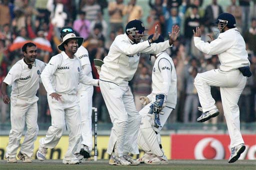 Mahendra Singh Dhoni, VVS Laxman, Amit Mishra and Sachin Tendulkar celebrate the dismissal of Andrew Flintoff during the third day of the second Test match between India and England in Mohali on Sunday. (AP Photo)