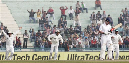 Sachin Tendulkar, Rahul Dravid, and VVS Laxman make a successful leg before wicket appeal against Andrew Strauss during the third day of the second Test between India and England in Mohali.