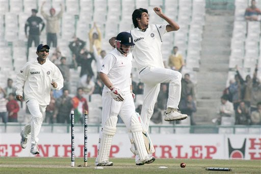 Ishant Sharma jumps in air after taking the wicket of Ian Bell while Gautam Gambhir joins-in to celebrate the dismissal of Bell during the third day of the second Test between India and England in Mohali.