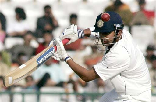 Gautam Gambhir hits a shot during the fourth day of the second Test match between India and England in Mohali on Monday. (AP Photo)