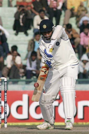 VVS Laxman hits a shot during the fourth day of the second Test match between India and England in Mohali on Monday. (AP Photo)