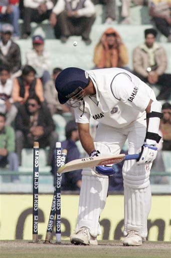 Rahul Dravid looks back to his shattered wickets as he is bowled by England's Stuart Broad during the fourth day of second Test match between India and England in Mohali on Monday. (AP Photo)